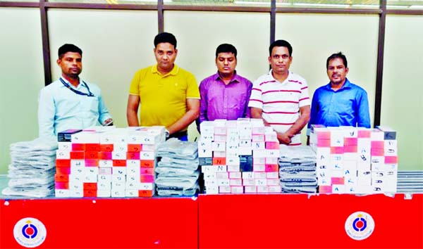 5 held with cell phone, laptops, gold ornaments at HSIA