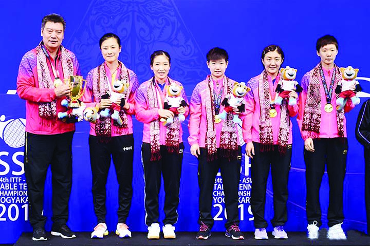 Members of China Women's team pose for photo during the award ceremony after winning the women's teams final match between China and Japan at the 2019 Asian Table Tennis Championships in Yogyakarta, Indonesia on Tuesday.