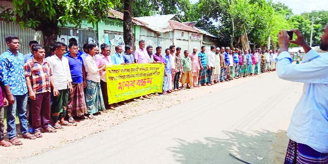 SHERPUR: Locals formed a human chain at Jhenaigathi Upazila protesting  attack on businessman Momin  on Wednesday.