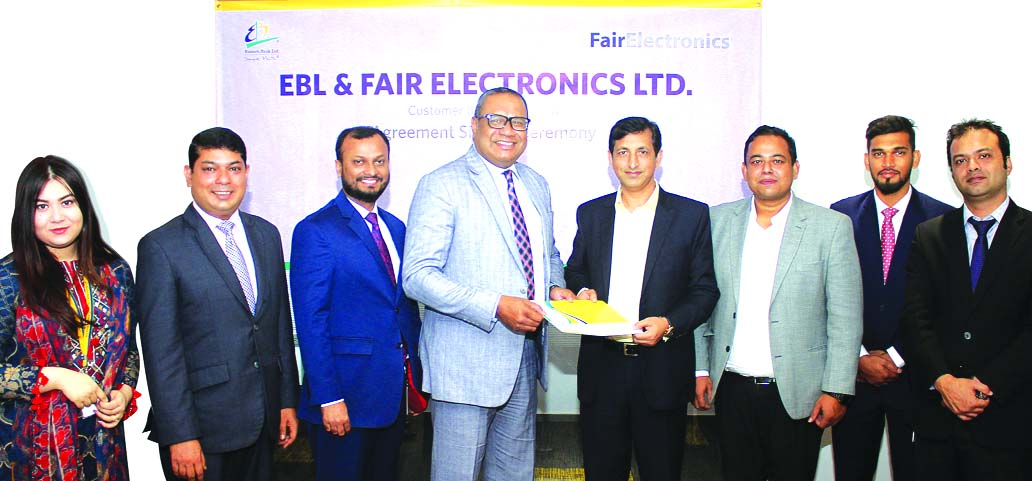 M. Khorshed Anowar, Head of Retail and SME Banking of Eastern Bank Limited (EBL) and J.M Taslim Kabir, Head of Marketing of Fair Electronics Limited, (authorized distributor and manufacturer of SAMSUNG products in Bangladesh) exchanging an agreement signing document at EBL head office in the city recently. Senior officials from both sides were also present.