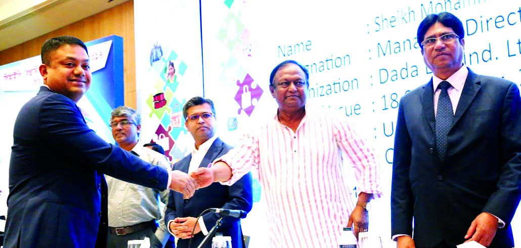 Sheikh Md. Abdul Wadood, Managing Director of Dada Group Limited, received the CIP card from Commerce Minister Tipu Munshi at a function held at a hotel in the city on Wednesday. Former Commerce Minister Tofail Ahmed and senior officials were also present.