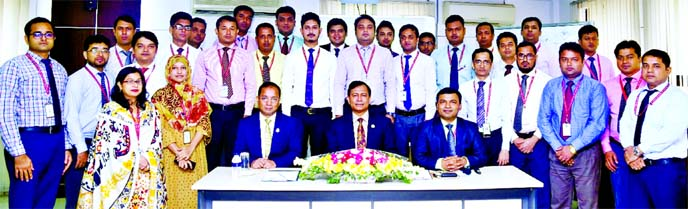 Md. TariqulAzam, AMD of Standard Bank Limited, poses for photograph with the participants of a day-long training on