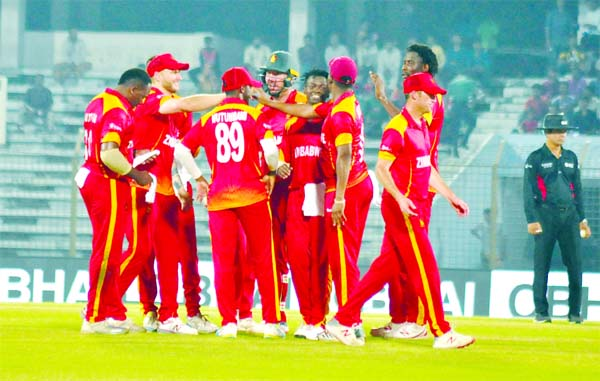 Players of Zimbabwe, celebrating after dismissal of Hazratullah Zazai during the fifth Twenty20 International Cricket match of the OBHAI Tri-nation T20 series between Zimbabwe and Afghanistan at the Zahur Ahmed Chowdhury Stadium in Chattogram on Friday. Afghanistan scored 155 for the loss of eight wickets in the allotted 20 overs.