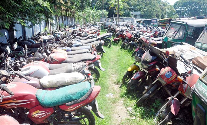 Motorcycles seized by CMP were left under the open sky at Sadarghat Duamping Station . This snap was taken yesterday.