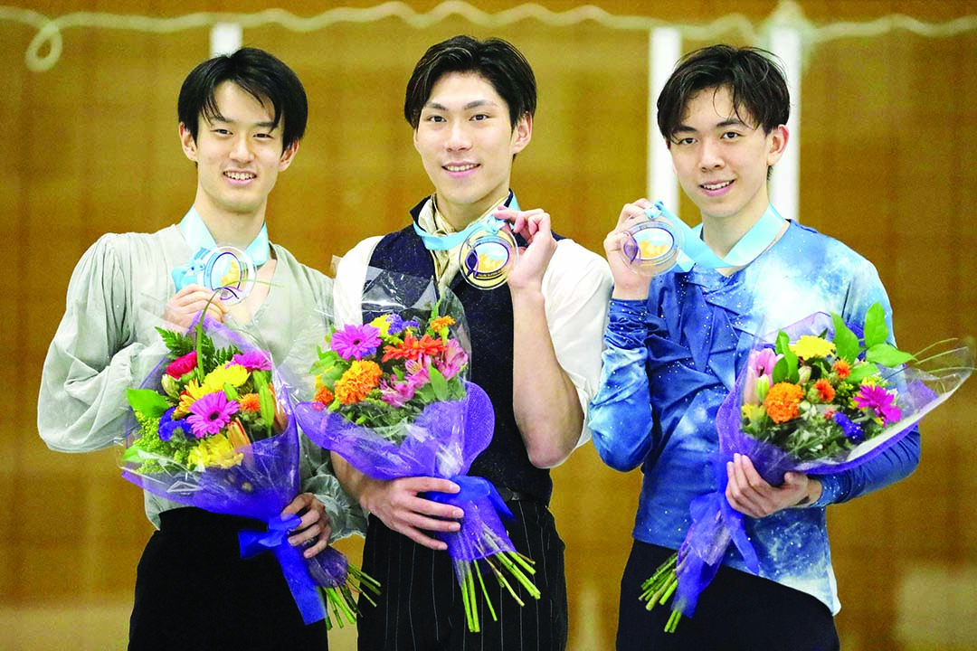 First-place finisher Keiji Tanaka (center) shares the podium with second-place Sota Yamamoto (left) both of Japan, and third-place finisher Vincent Zhou (right) of the United States, following the men's competition at the U.S. International Figure Skating Classic in Salt Lake City on Friday.