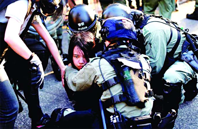 HK police fire teargas to disperse protesters