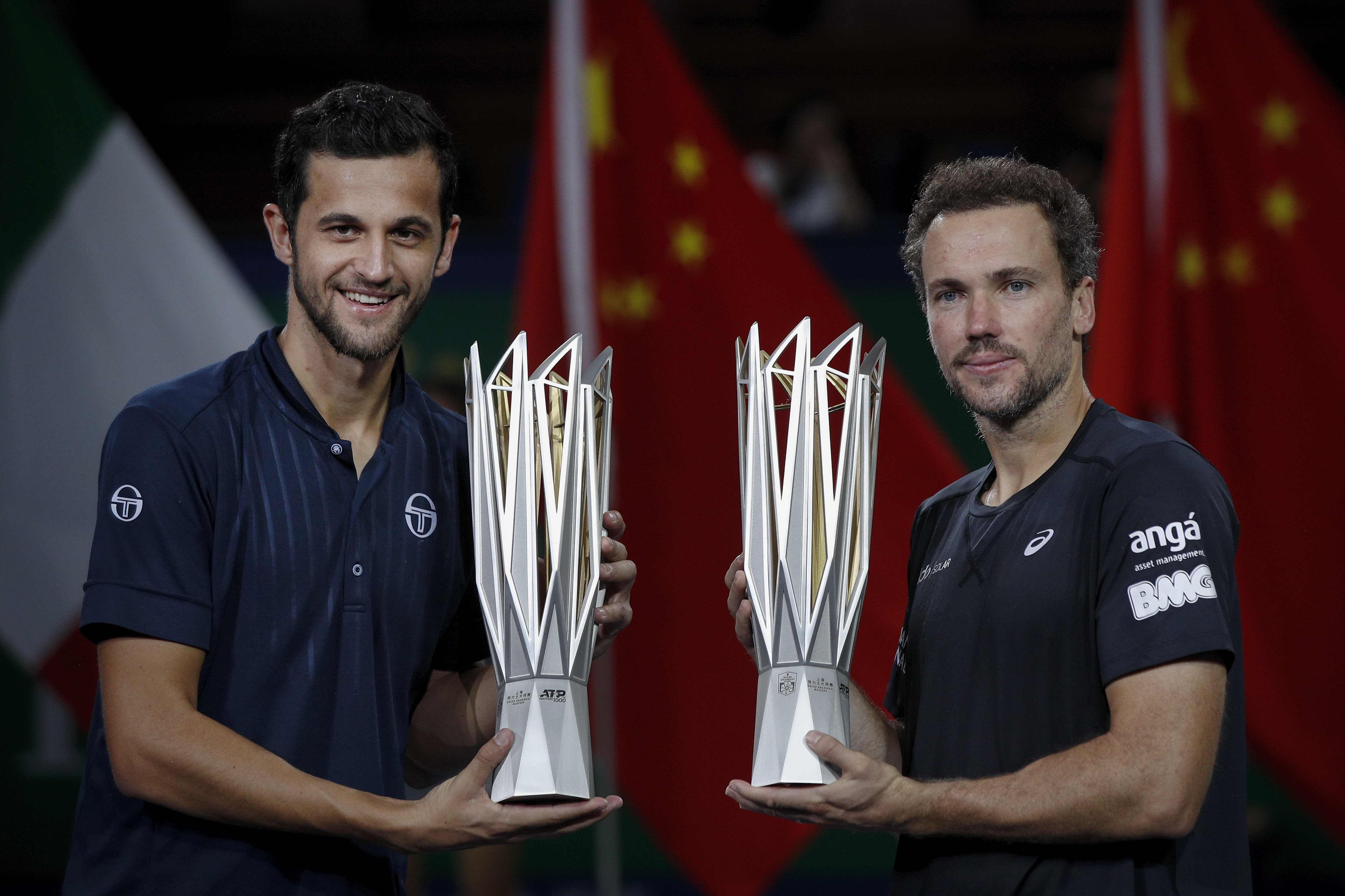 Mate Pavic of Croatia ( left) and his partner Bruno Soares of Brazil hold their winner trophies after defeating Lukasz Kubot of Poland and Marcelo Melo of Brazil in the men's doubles final at the Shanghai Masters tennis tournament at Qizhong Forest Sports City Tennis Center in Shanghai, China on Sunday.