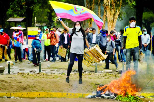 Demonstrators set up barricades near the National Assembly of Ecuador capitals in Quito.