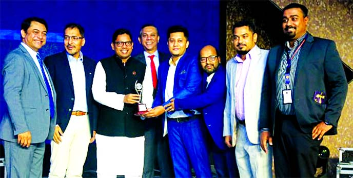 Syed Akthar Hasan Uddin, Director along with Shamim Ahmed, Chief Operating Officer of Guardian Life Insurance Limited (GLIL), receiving the BASIS National ICT Awards-2019 from State Minister for ICT Division Zunaid Ahmed Palak, for securing the 1st Runner Up place in Banking, Insurance & Finance Category at a hotel in the city on Friday. The company earned this recognition for EasyLife- an app based digital life insurance platform which is the first of its kind in the country.