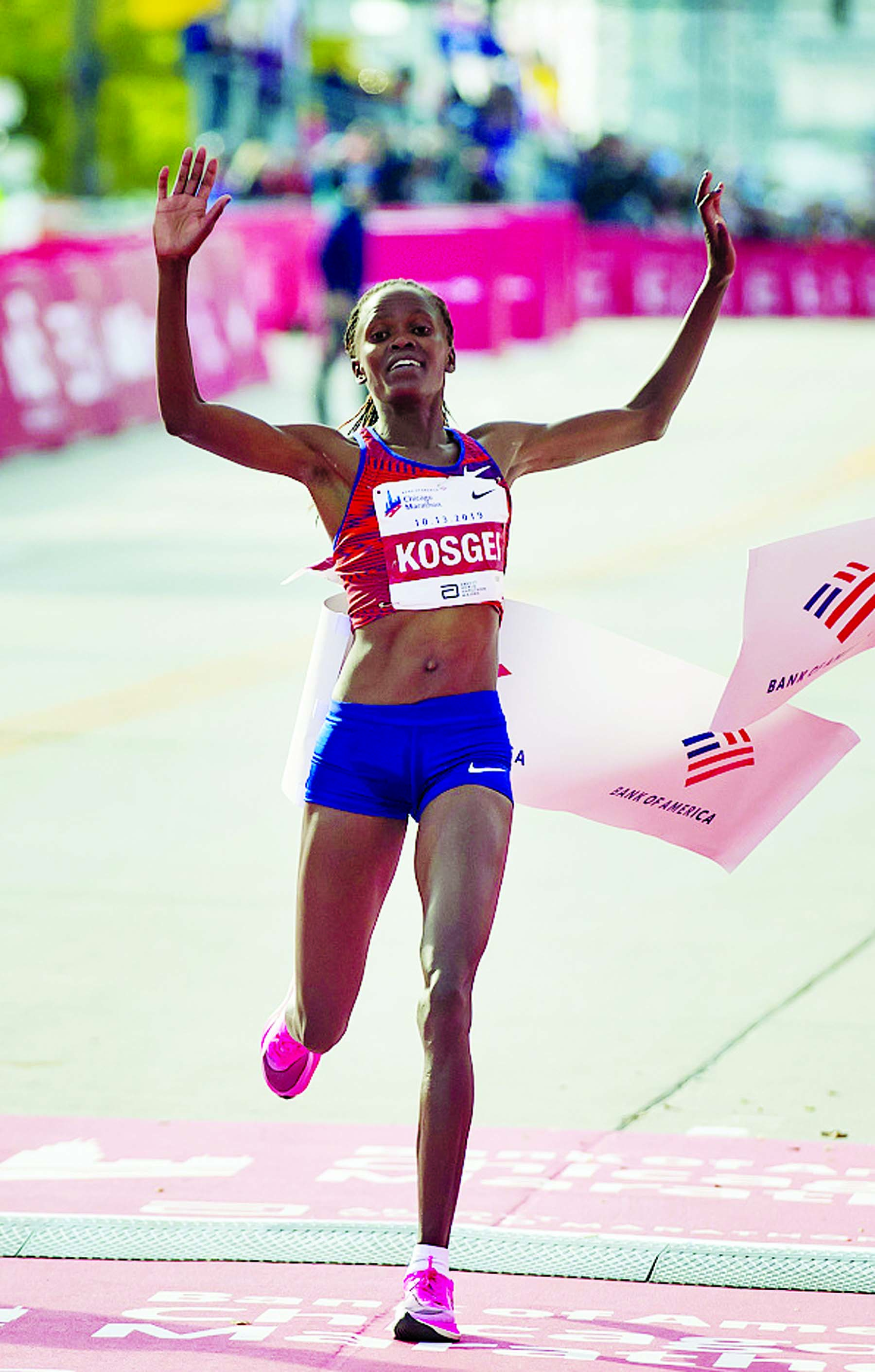 Brigid Kosgei wins the Women's Marathon in World record time  in the Chicago Marathon on Sunday.