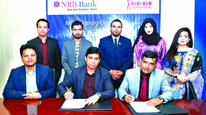 Mir Shafiqul Islam, Head of Cards of NRB Bank Limited and Muhammad Zahidul Hoque, CEO of Bio-Xin Cosmeceuticals, exchanging an agreement signing document at the bank's head office in the city recently. Under the deal, Debit and Credit Cardholders of the bank will get 20 per cent discount of all products and treatments at the cosmeceuticals company. Senior officials from both the organizations were also present.