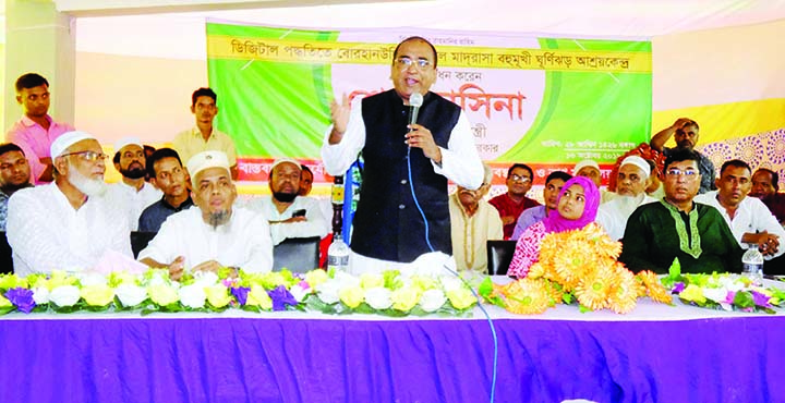 BHOLA: Ali Azam Mukul MP speaking at the inaugural prgramme of cyclone centre at Borhanuddin Kamil Madrasa  at Borhanuddin Upazila as Chief Guest yesterday.