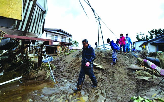 Clean-up, rescue efforts in Japan as typhoon toll nears 70