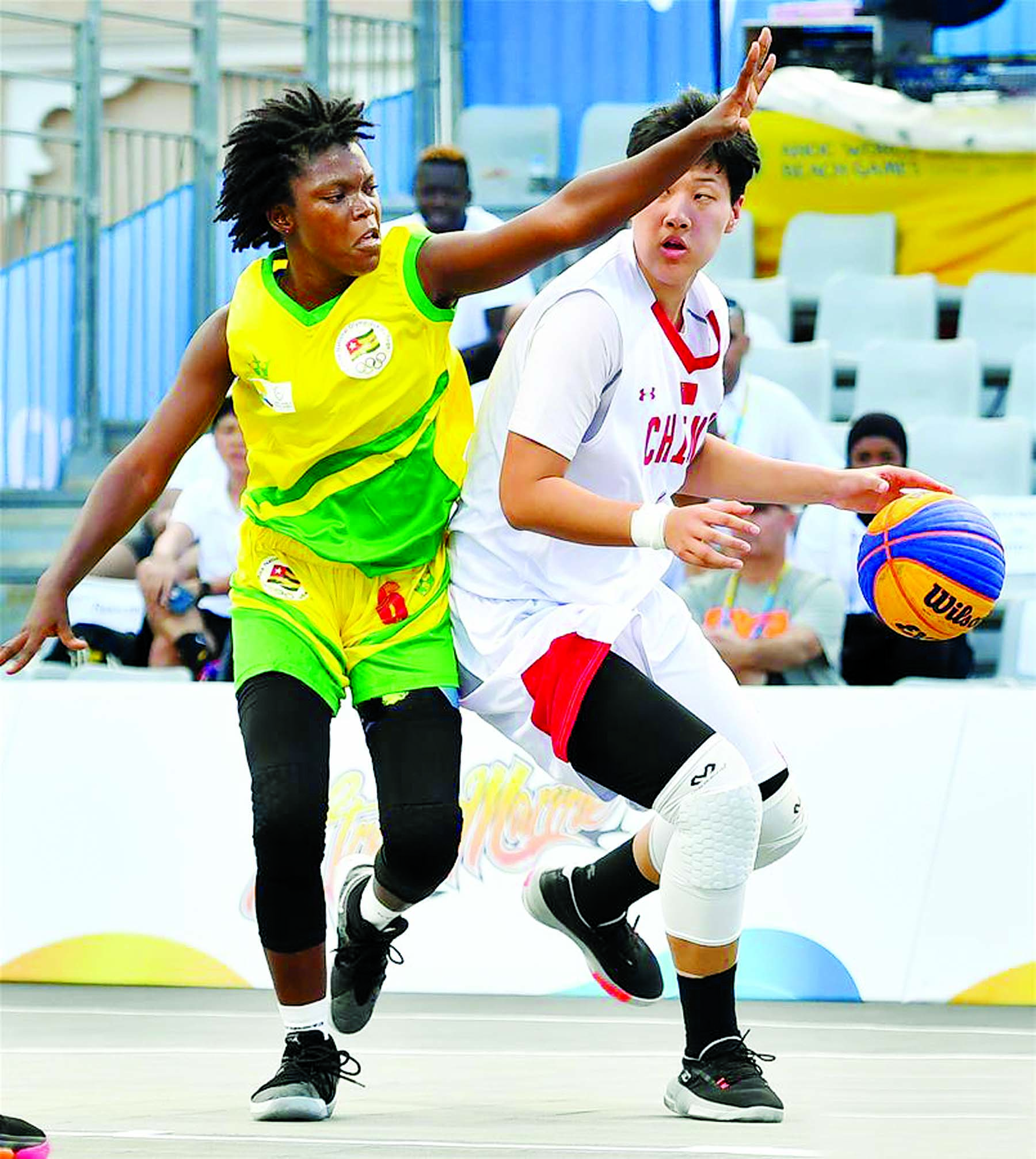 Ha Wenxi (right) of China, vies with Pierrette Adjovi Donouvi of Togo, during the 3x3 women's Team Group B match between China and Togo at the 1st ANOC World Beach Games Qatar 2019 in Doha, capital of Qatar on Monday.