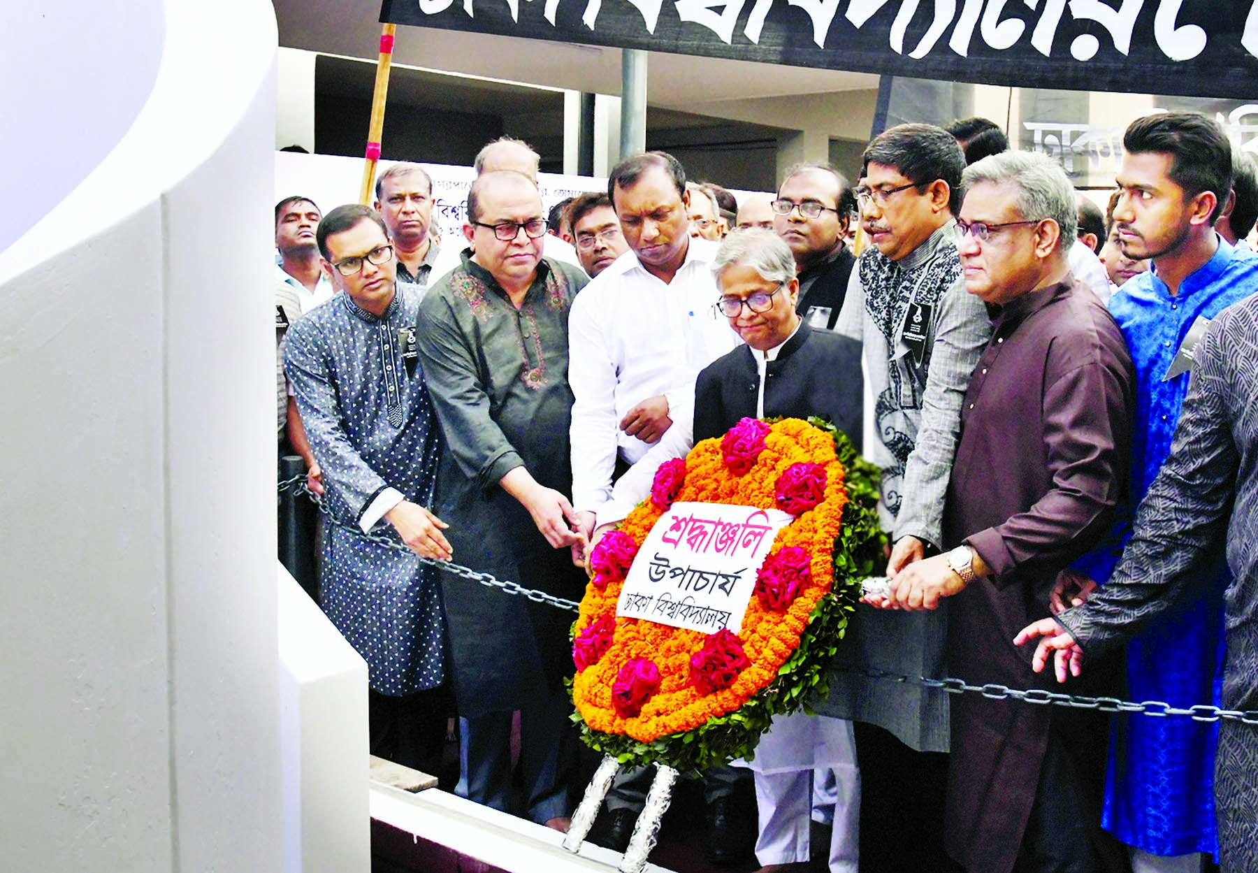 Vice-Chancellor of Dhaka University Prof Dr Akhtaruzzaman placing floral wreaths at Jagannath Hall Memorial Plaque of the university on Tuesday marking Mourning Day of DU.