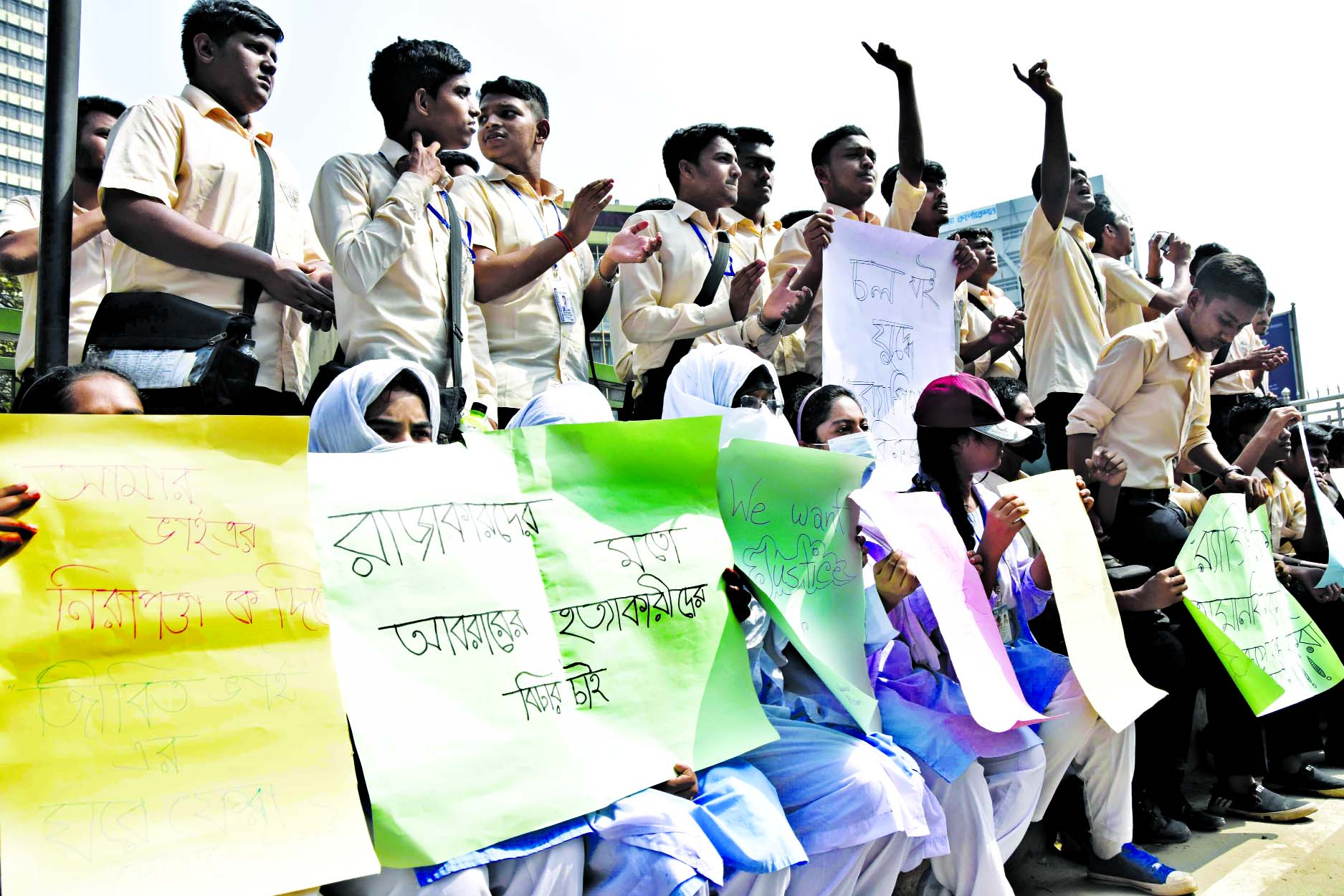 Notre Dame College students take to street with placards protesting killing of BUET student Abrar Fahad and demanding capital punishment to killers on Tuesday.