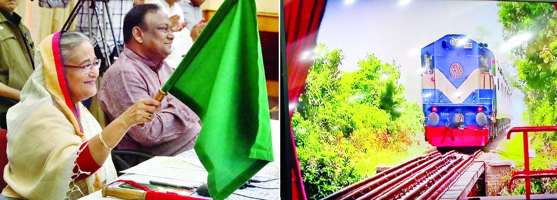 Prime Minister Sheikh Hasina inaugurating new inter-city train 'Kurigram Express' in Kurigram-Dhaka route waving flag through video conference at Ganobhaban on Wednesday.