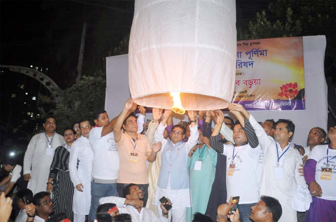 Barrister Biplob Barua, Special Assistant to Prime Minister inaugurating Prabartana Purnima, the second largest festival of the Buddhist Community by releasing candle-lit air balloons at Nandan Kanan Bouddha Bihar in Port City on Monday.