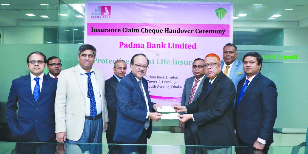 Md. Yousuf Ali Mridha, CEO of Protective Life Insurance Limited, handing over a cheque to Md. Ehsan Khasru, CEO of Padma Bank Limited at its head office in the city on Tuesday. Senior officials from both the sides were also present on the occasion.