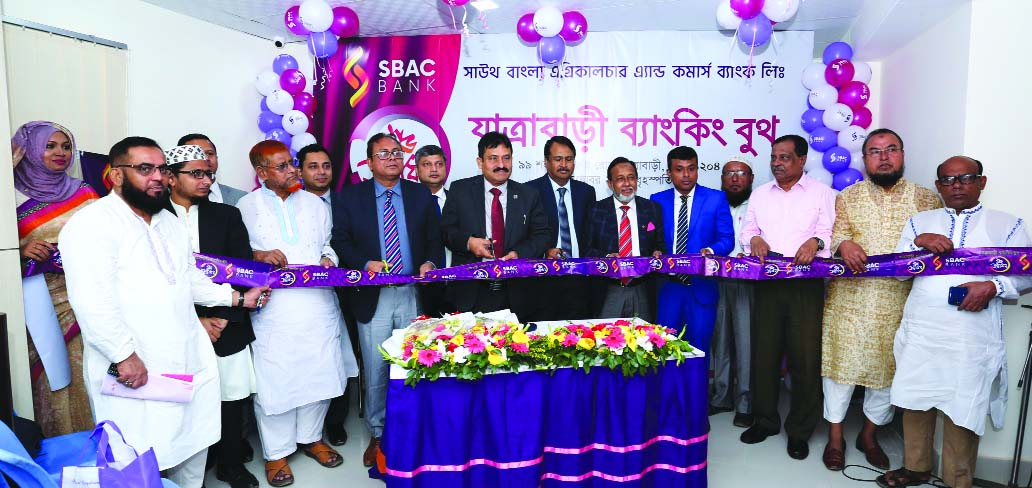 Mostafa Jalal Uddin Ahmed, AMD of South Bangla Agriculture and Commerce Bank Limited, inaugurating its Banking Booth at Shahid Faruque Road in city's Jatrabari area on Thursday. Md. Mamunur Rashid Molla, DMD, Tariqul Islam Chowdhury, Head of GSD of the bank and local elites were also present.