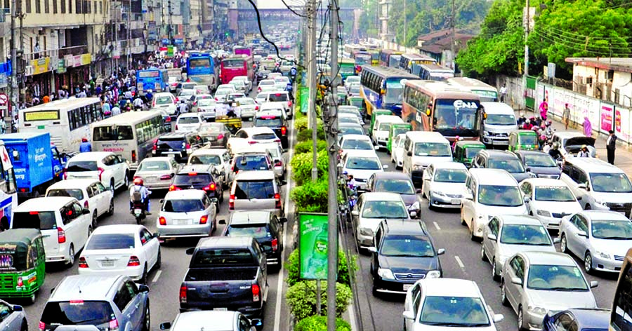 Thousands of cars get stranded for hours on key roads in Dhaka city on Thursday, as the capital was blighted by severe traffic jam on the eve of weekend. This snap was taken at 12.30pm from Banani main road.