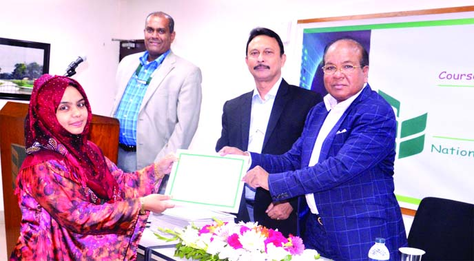 A S M Bulbul, Head of Human Resources Division of National Bank Limited, distributing certificates among the participants of a 12 day-long training programme on