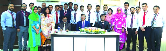 Md Tariqul Azam, Managing Director (acting) of Standard Bank Limited, poses along with participants after attending a two day-long workshop on