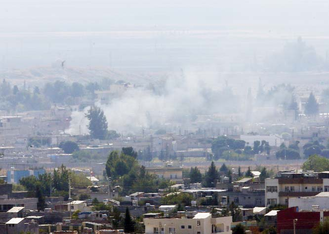 Fighting in Kurdish-held Syrian town despite cease-fire