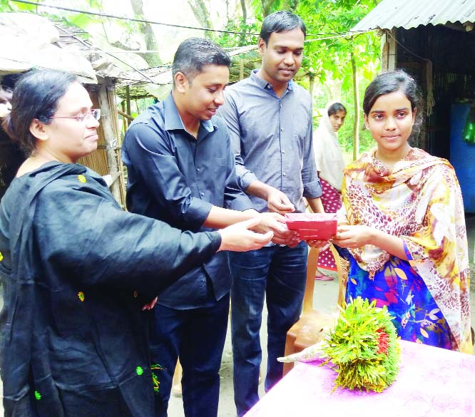BHANGURA (Pabna): Syed Asrafuj Jaman, UNO greetings Trisha Parvin on Friday who got chance in the MBBS admission at Habiganj Govt Medical College recently.