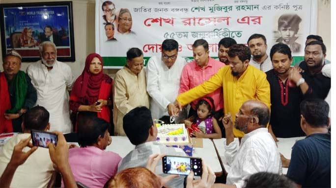 M A Latif MP cutting cake at the Port City marking the birthday of Sheikh Russel on Friday.