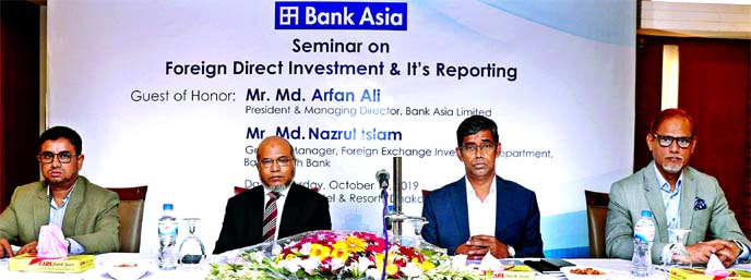 Md Arfan Ali, President & Managing Director of Bank Asia Ltd, presiding over a Seminar on 'Foreign Direct Investment (FDI) & It's Reporting' at a city hotel on Saturday. Md Nazrul Islam, General Manager of  Foreign Exchange Investment Department of Bangladesh Bank and Md Sazzad Hossain, DMD and Md Zia Arfin, Head of International Division of Bank Asia, among others, were present.