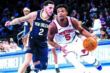 New York Knicks guard Dennis Smith Jr. (5) drives to the basket against New Orleans Pelicans guard Lonzo Ball (2) during the second half of a preseason NBA basketball game at Madison Square Garden in New York on Friday.