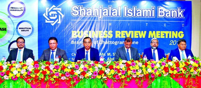M. Shahidul Islam, CEO of Shahjalal Islami Bank Limited (SJIBL), presiding over its Business Review Meeting with the officials of Chattogram & Cox's Bazar area branches at a local hotel in Chattogram on Saturday. Abdul Aziz, AMD, Khondkar Rafiq-Uz-Zaman, Chattogram Zonal Head and other executives of the bank were also present.
