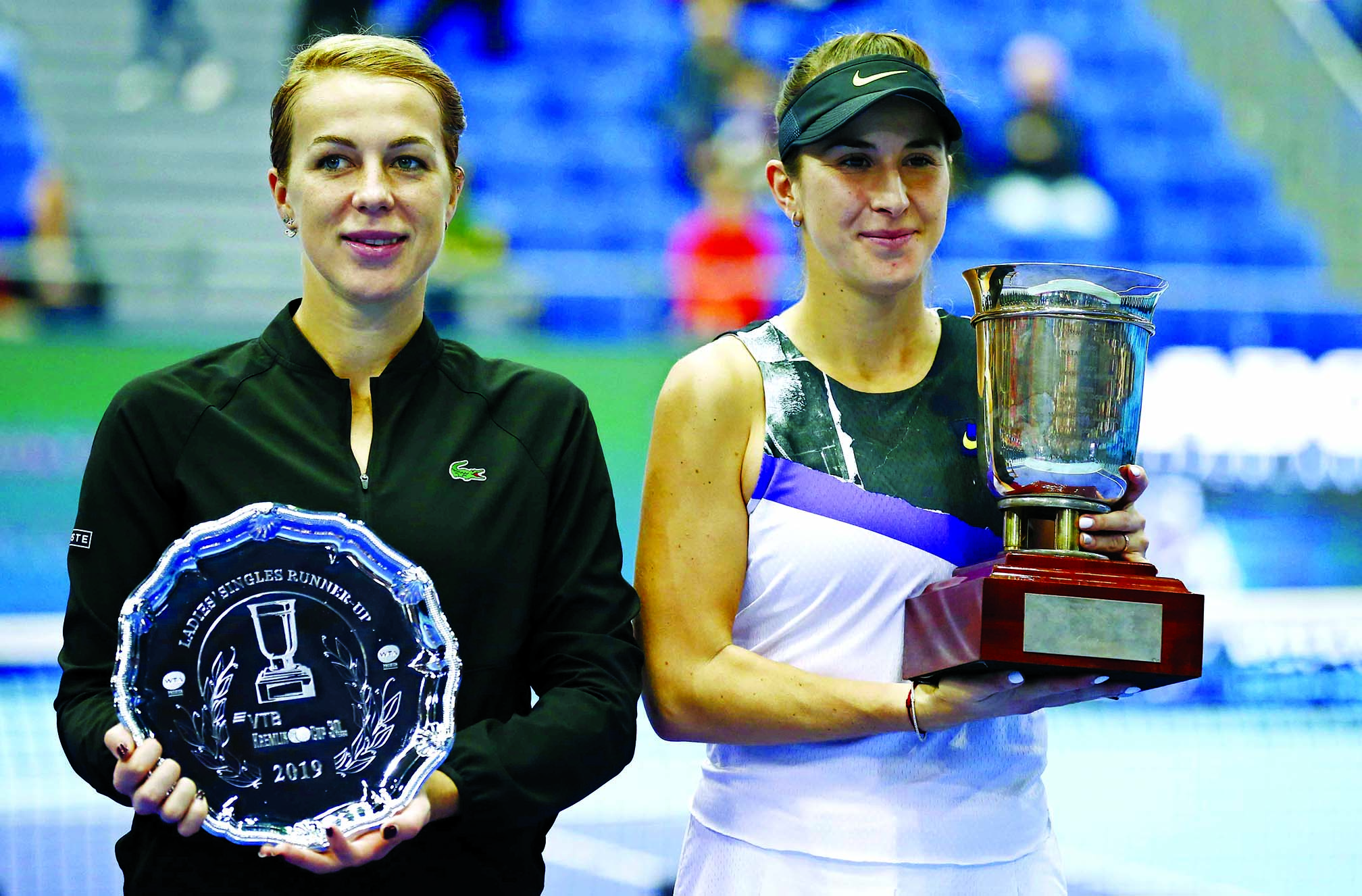 Belinda Bencic of Switzerland, first place (right) and Anastasia Pavlyuchenkova of Russia, second place hold their trophies after the final match of the Kremlin Cup tennis tournament in Moscow, Russia on Sunday.