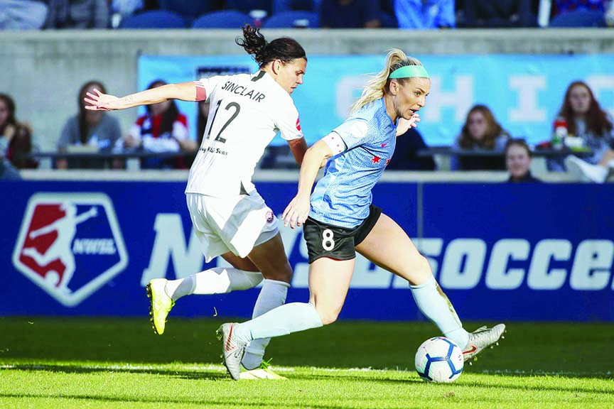 Chicago Red Stars midfielder Julie Ertz (8) defends against Portland Thorns FC forward Christine Sinclair (12) during the second half of an NWSL playoffs semi-final soccer match in Bridgeview, Ill on Sunday.