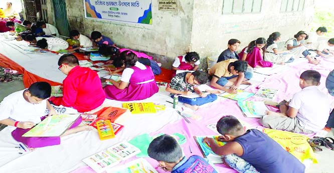 MIRZAPUR (Tangail): Children  participating in a art competition on the occasion of the 10th founding anniversary  of Mohona TV at Sheikh Russel Stadium at Mirzapur Upazila on Sunday.