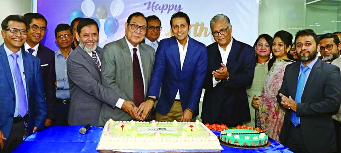 A. Rouf Chowdhury, Chairman of Bank Asia Limited and ERA-InfoTech Limited, celebrating its 17th anniversary by cutting a cake at its office in the city recently. Mihir Kanti Majumdar, Chairman, Palli Sanchay Bank, Syed Almas Kabir, President of Bangladesh Software and Information Services Association (BASIS), Md. Arfan Ali, Managing Director of Bank Asia Limited and other high officials from different sectors were also present.