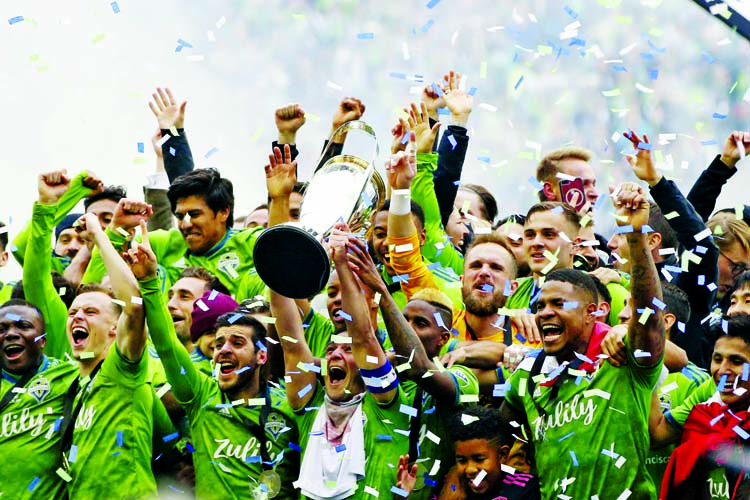 The Seattle Sounders celebrate after winning the MLS Cup soccer match 3-1 over Toronto FC on Sunday.