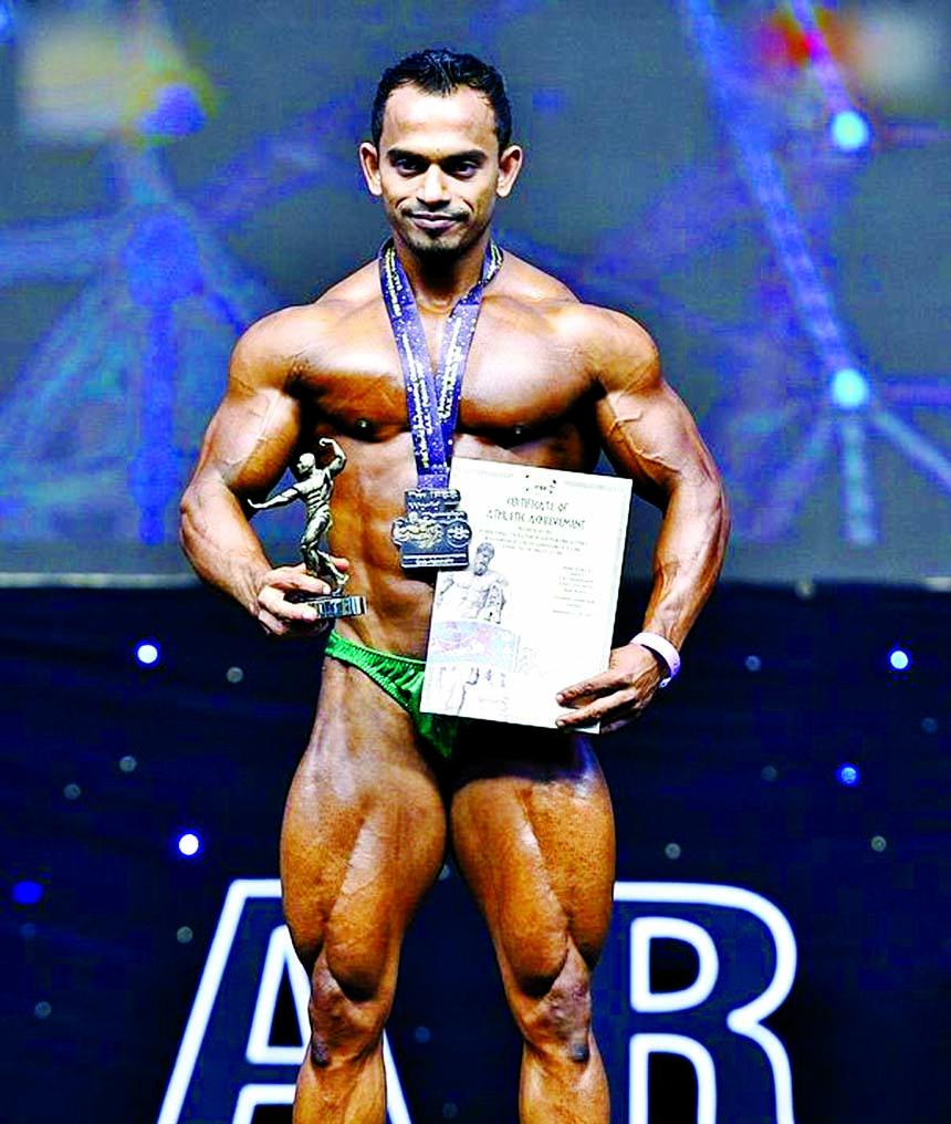 Mister Bangladesh Robin poses with his silver medal, award and certificate after he becoming second in the 60 kg category of IFBB 73rd World Bodybuilding Championship at Zayed Sports Complex in Al-Fujairah, United Arab Emirates recently.