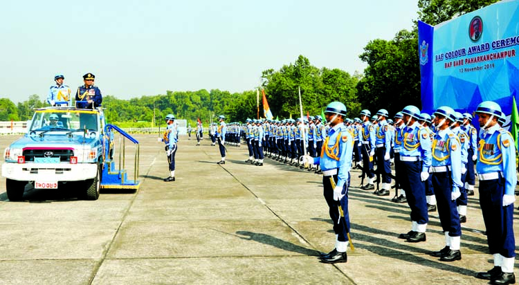 Chief of Air Staff Air Chief Marshal Masihuzzaman Serniabat reviewing parade on the occasion of BAF colour awarding to BAF Base Paharkanchanpur in Tangail on Wednesday.