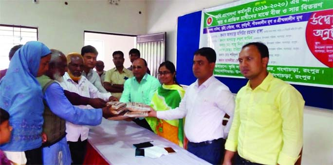 GANGACHARA (Rangpur):  Saju Ahmed Lal, UNO distributing  free seeds and fertilizer among the farmers  organised by Agriculture Extension Department on Tuesday.
