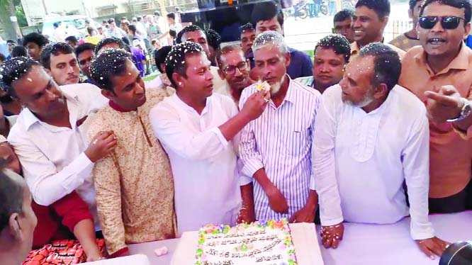 SAGHATA (Gaibandha):  Leaders of Saghata Upazila Awami League and  Jubo League  cutting  cake  on the occasion of the founding anniversary of Jubo League on Monday.