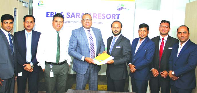M Khorshed Anowar, Head of Retail and SME Banking of Eastern Bank Limited (EBL) and Ahmad Raquib, General Manager (Branding, Sales and Reservation) of Sarah Resort Limited, exchanging documents after signing an agreement at the bank's head office in the city recently. Under the deal, VISA, Mastercard, Diners Club International, Discover and Union Pay International cardholders of the bank and any other banks can avail services from Sarah Resort at Gazipur using EBL POS (Point of Sale) terminals. Senior officials from both sides were also present.