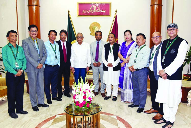 President Abdul Hamid poses for a photo session with the members of Trustee Board of Bouddha Religious Welfare Trust when they called on President at Bangabhaban on Monday.
