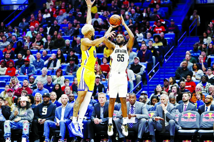 New Orleans Pelicans guard E'Twaun Moore (55) shoots over Golden State Warriors guard Ky Bowman (12) in the second half of an NBA basketball game in New Orleans on Sunday.