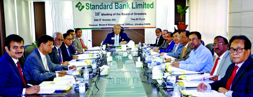 Kazi Akram Uddin Ahmed, Chairman of Standard Bank Limited, presiding over its 320th Board of Directors Meeting at the bank's head office in the city on Monday. Kamal Mostafa Chowdhury, Ashok Kumar Saha, Ferozur Rahman, S A M Hossain, Mohammed Abdul Aziz, Md. Zahedul Hoque, Ferdous Ali Khan, Mohd. Yousuf Chowdhury, Md. Abul Hossain, Najmul Huq Chaudhury, Md. Nazmus Salehin, Directors and Md. Tariqul Azam, Managing Director of the bank were also present.