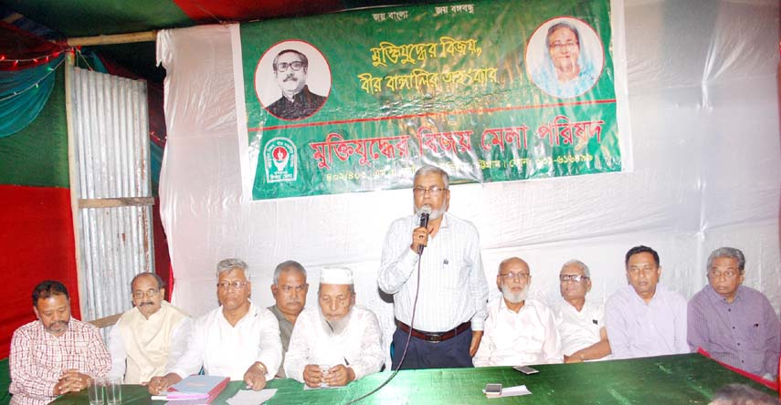 Commander M A Monsur Uddin speaking at a  meeting of Muktijoddher Bijoy Mela Parishad at Port City.