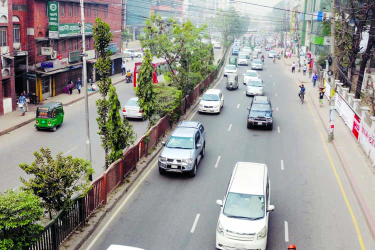 Sparse presence of vehicles on the city streets after implementation of new road law. The snap was taken from the city's Sobhanbag (Mirpur Road) on Tuesday.