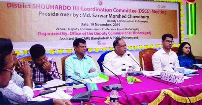KISHOREGANJ:  Md Morshed Chowdhury, DC ,  Kishoreganj addressing  a coordination meeting of CARE Souhardo-3  at Collectorate Conference Room  on Tuesday.