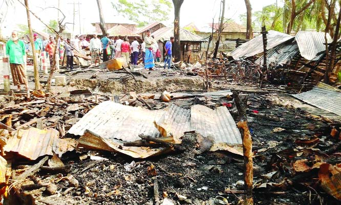 MORELGANJ(Bagerhat): A devastating fire gutted a house and four shops at Madrasa Bazar in Morelganj on Tuesday night.